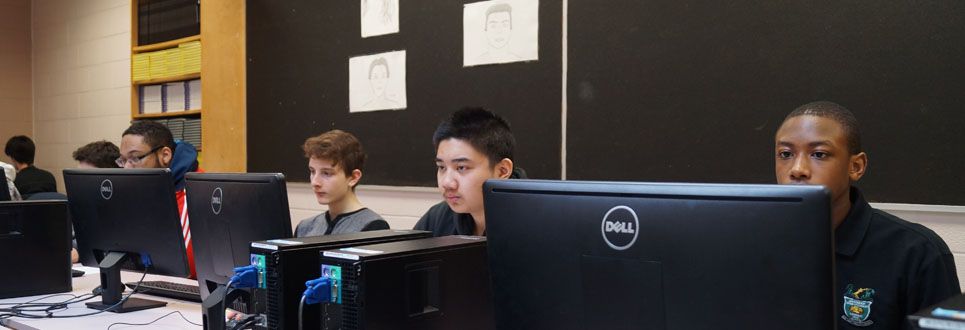 students using desktop computers